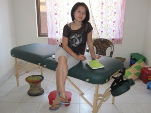 Sonya in the clinic room with the donated massage table